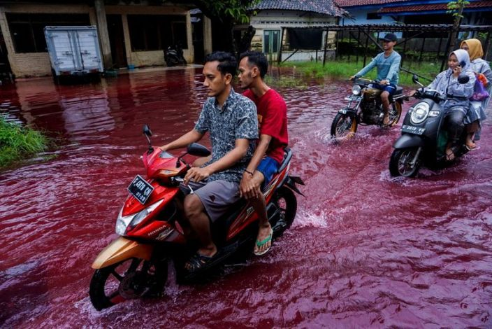 Indonesian village turns blood-like red as floods hit batik-manufacturing hub